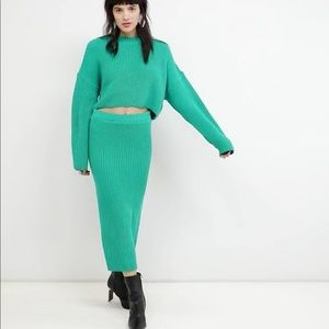 Asks two piece turquoise skirt and sweater set